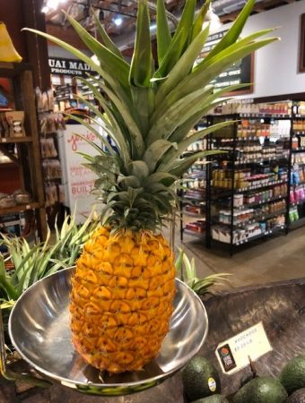 pineapple on scale in Kauai local market