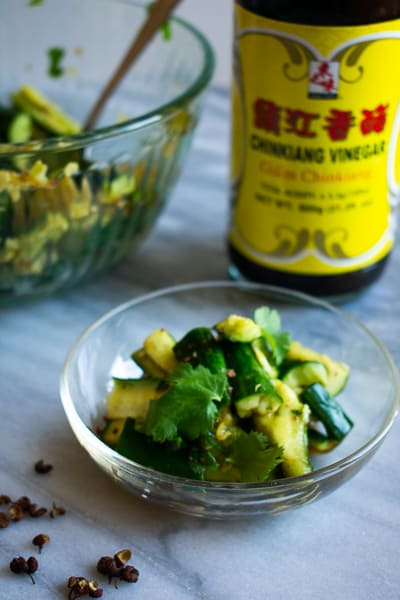 smashed cucumber salad with chinese black vinegar bottle in the back