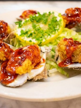 what to eat in new orleans - fried oysters with chili sauce