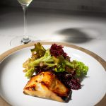 miso marinated black cod with wine and lettuce greens