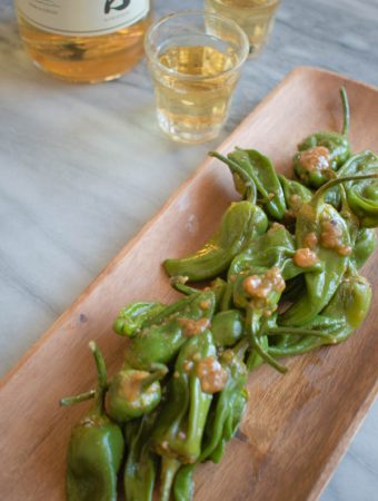 miso padron peppers recipe on brown plate with whisky