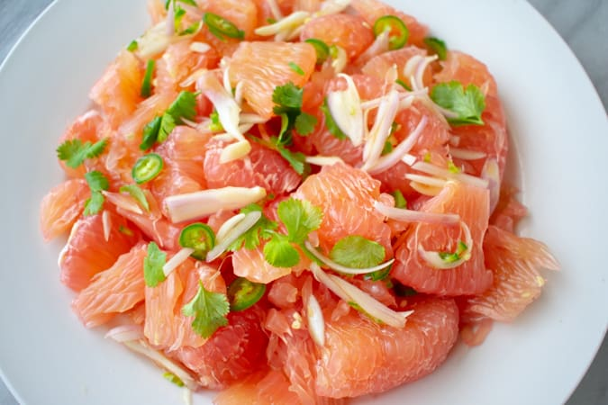 pomelo salad on a white plate
