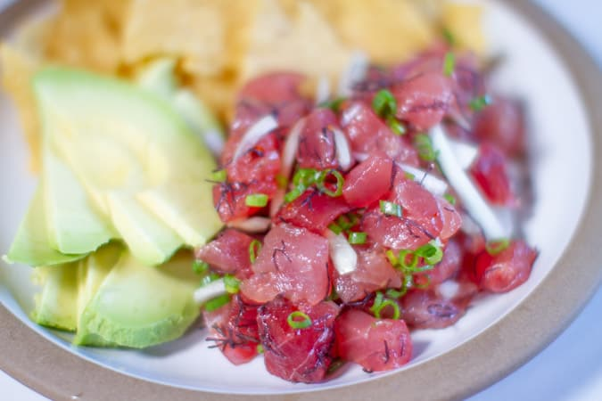 Hawaiian poke with avocado on plate