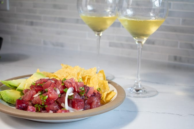 Hawaiian poke with 2 glasses wine