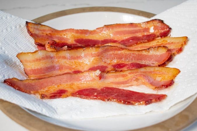 bacon strips on plate with paper towel