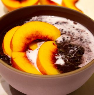 superfood black rice pudding with peaches and coconut milk