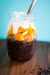 superfood black rice pudding with pumpkin and coconut cream