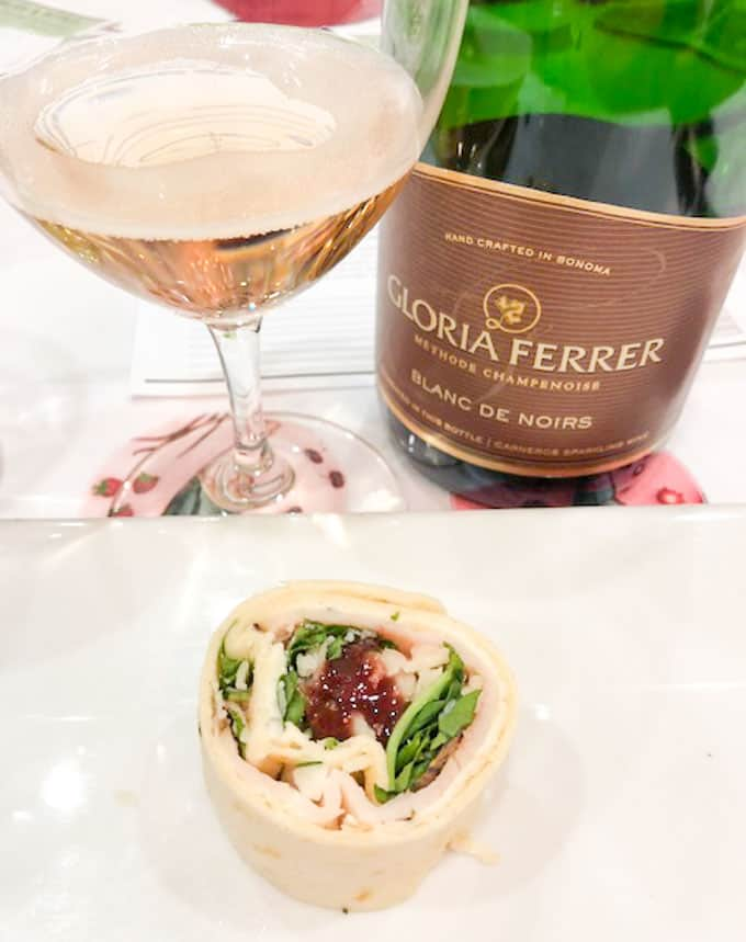 gloria ferrer blanc de noirs wine with turkey pinwheel
