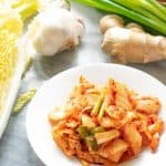 kimchi on white plate with vegetables