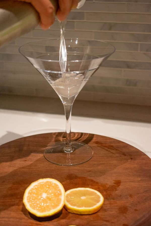 lemon drop being poured into martini glass