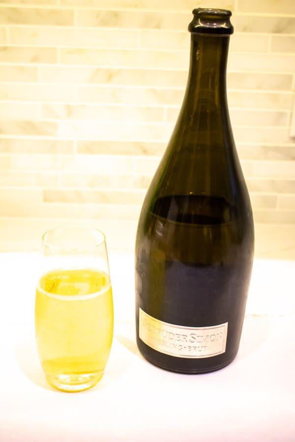 sparkling riesling bottle and glass of wine