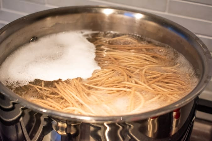 soba noodles cooking in pot