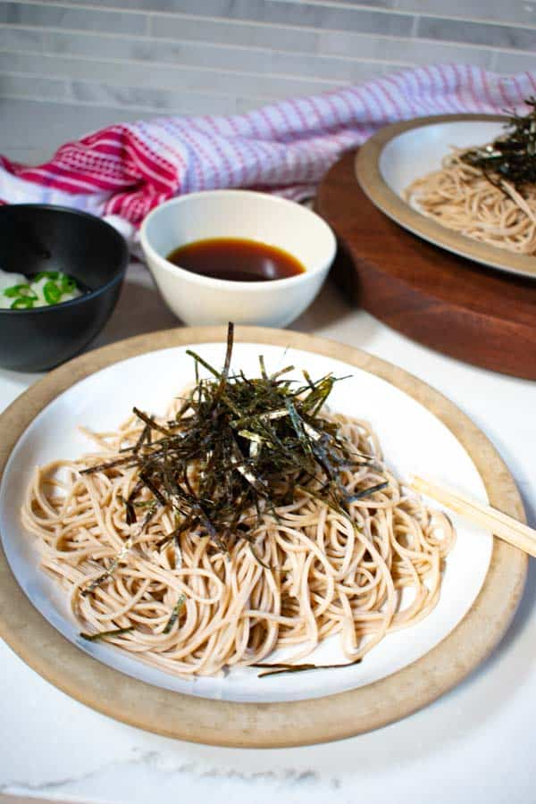 soba noodles sauce with soba on plate