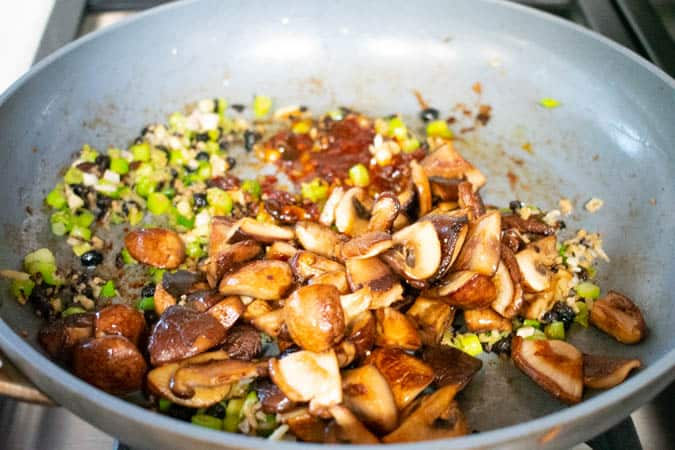 Vegan Mapo Tofu with mushrooms and ginger in pan