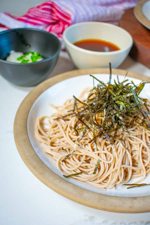 soba noodles on plate with dipping sauce