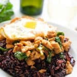 thai basil chicken with fried egg and purple rice