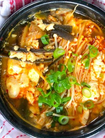 Vegan Korean Soft Tofu Soup or Soondubu Jigae in black pot