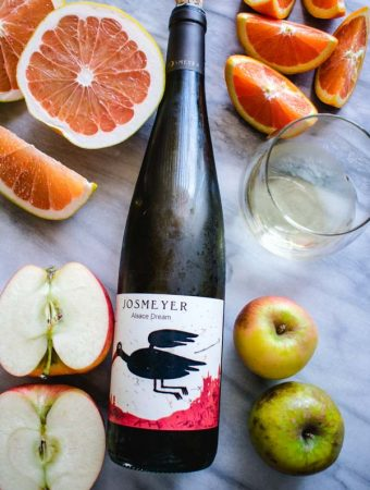 bottle of Josmeyer Alsace Dream with sliced apples and oranges