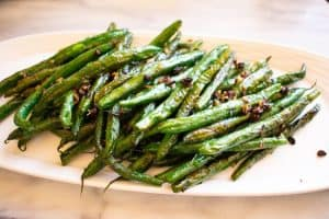 Blackened blue lake green beans on a white plate