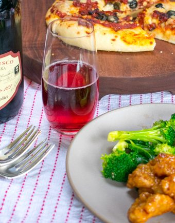 Lambrusco wine with orange chicken and pizza.