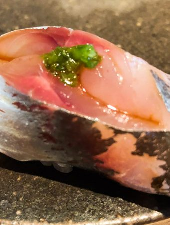 King Mackerel nigiri on black plate