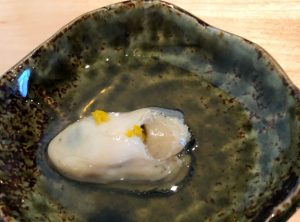A Washington oyster lightly poached with soy and mirin, topped with fresh yuzu zest.