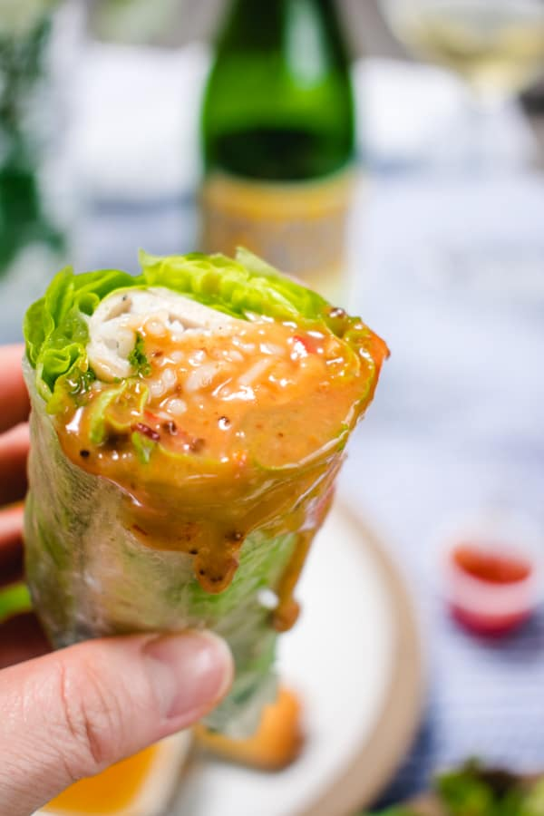 Fresh Vietnamese Spring Roll Dipped into Peanut Sauce