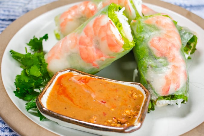 Plate of Fresh Shrimp Spring Rolls with a small dish of peanut sauce
