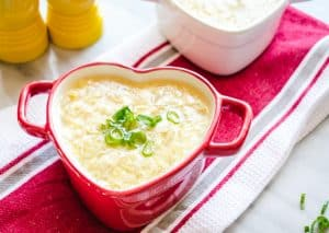Egg drop soup in a mini red heart ceramic pot