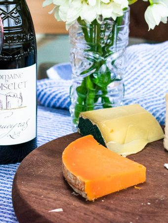3 French Cheeses and a bottle and glass of Vacqueyras French red wine