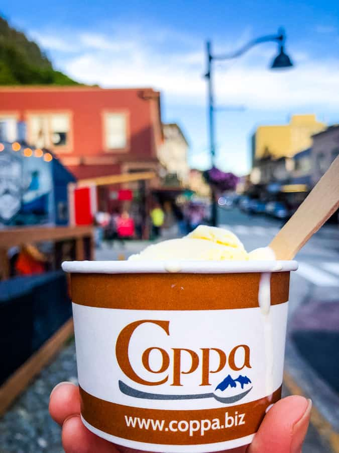 Cup of Coppa Ice Cream with downtown Juneau, Alaska in the background