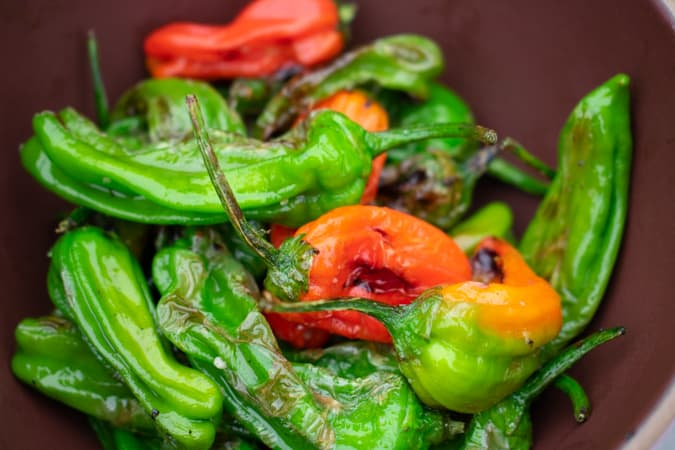 BBQ Shishito peppers in a bowl