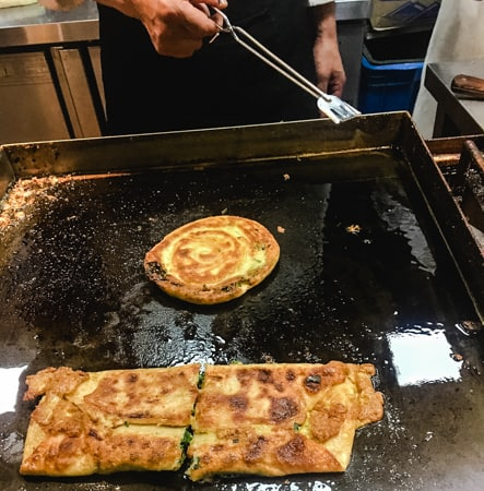 Scallion pancakes on the griddle in Shanghai, China