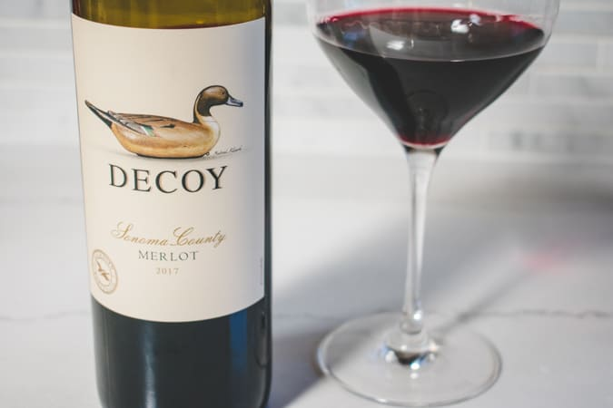 Bottle and glass of Decoy Sonoma County 2017 Merlot