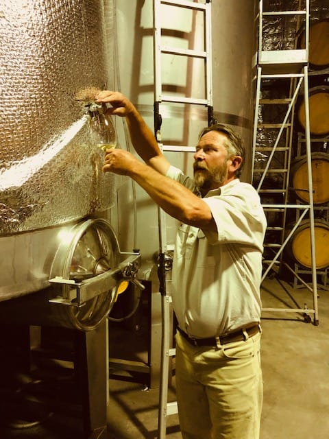 Winemaker Michael Bourke pouring wine from the tank at Jester Hill Wines