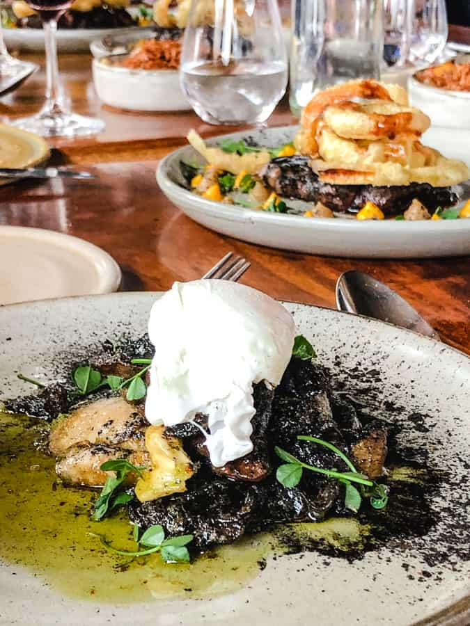 Braised mushrooms with poached egg and truffle oil