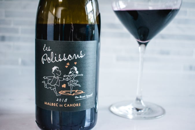 bottle and glass of Les Polissons Malbec de Cahors