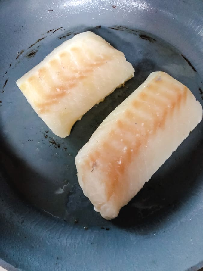 2 fillets of skinless cod in a non stick pan