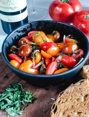 black Bowl of marinated asian tomato salad