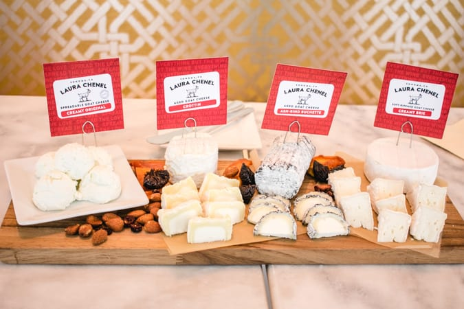 Selection of Laura Chenel cheeses on a wooden cutting board