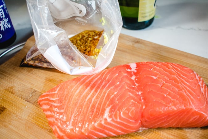 Salmon fillet and open ziploc bag with Japanese marinade