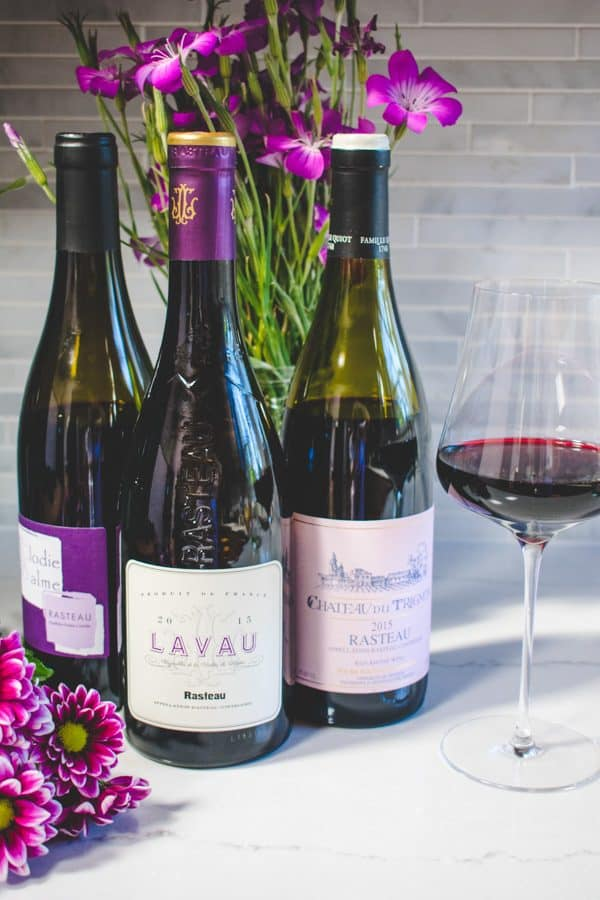 3 bottles of Rasteau wine, purple flowers, and a glass of wine