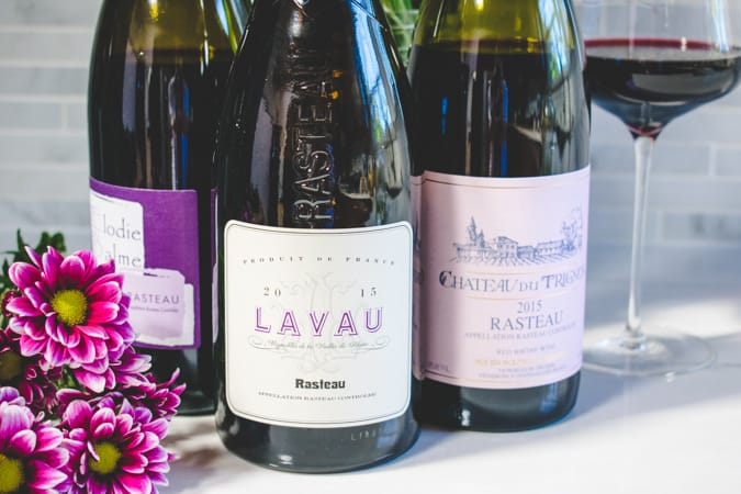 close up shot of 3 bottles of Rasteau wine with purple flowers
