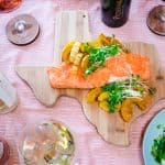 Texas cutting board with salmon and squash with selection of Pedernales Cellars wines