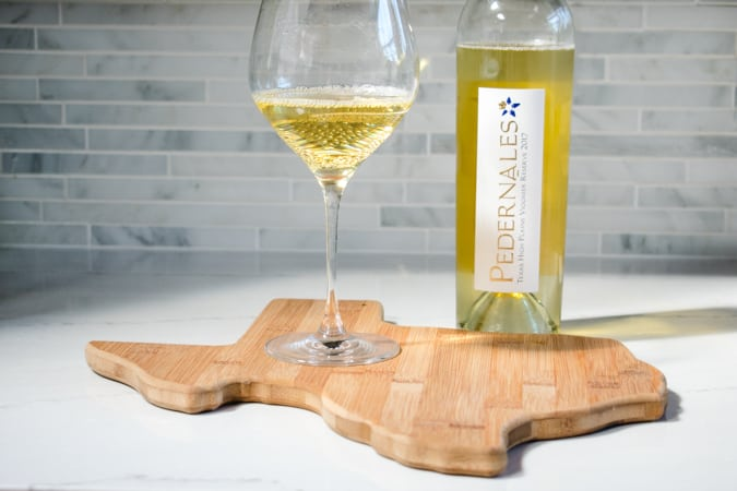 Pedernales Cellars wine on a cutting board