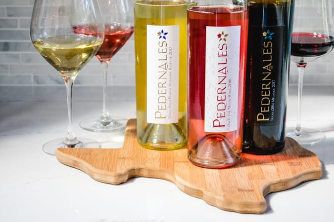 Pedernales Cellars viognier, rose, and GSM on a cutting board