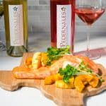 Salmon on a cutting board with Rose and Viognier from Pedernales Cellars