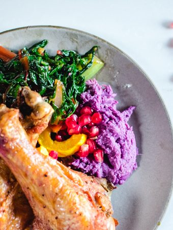 Purple yam mash on a plate with turkey dinner