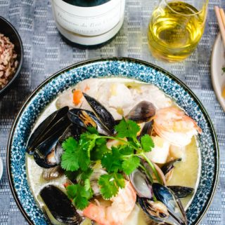Asian Cioppino with with rice, white wine, and greens on the side