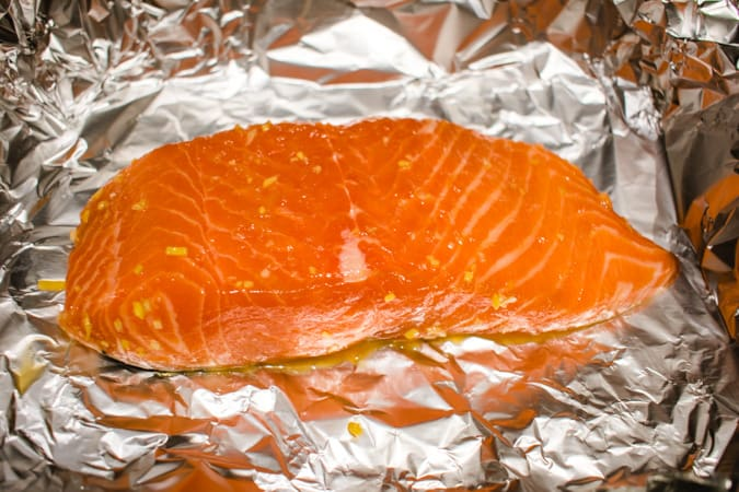 Raw salmon filet on foil for Japanese marinated salmon